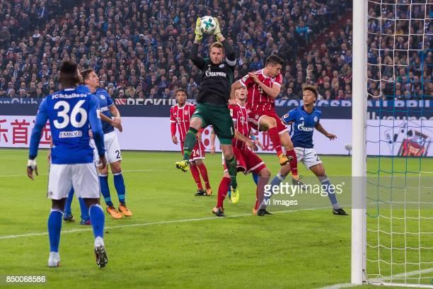 Breel Embolo of FC Schalke 04 Ronaldo Aparecido Rodrigues of FC Schalke 04 Bastian Oczipka of FC Schalke 04 Corentin Tolisso of FC Bayern Munich...