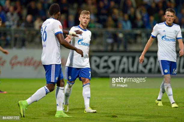 Breel Embolo of Schalke and Max Meyer of Schalke and Fabian Reese of Schalke celebrate a goal during the preseason friendly match between FC...