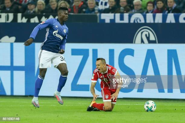 Breel Embolo of Schalke and Rafinha of Bayern Muenchen battle for the ball during the Bundesliga match between FC Schalke 04 and FC Bayern Muenchen...