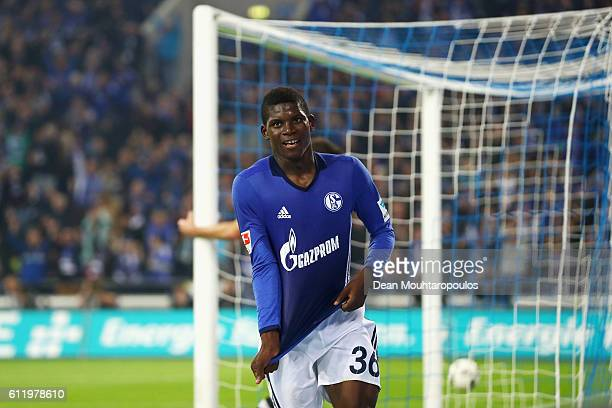 Breel Embolo of Schalke celebrates scoring his teams fourth goal of the game during the Bundesliga match between FC Schalke 04 and Borussia...