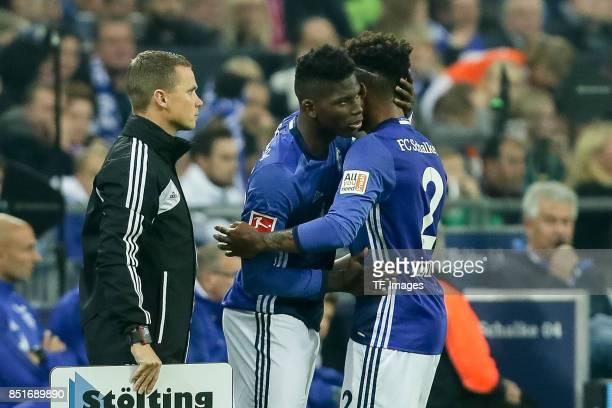 Breel Embolo of Schalke shakes hands with Weston McKennie of Schalke during the Bundesliga match between FC Schalke 04 and FC Bayern Muenchen at...