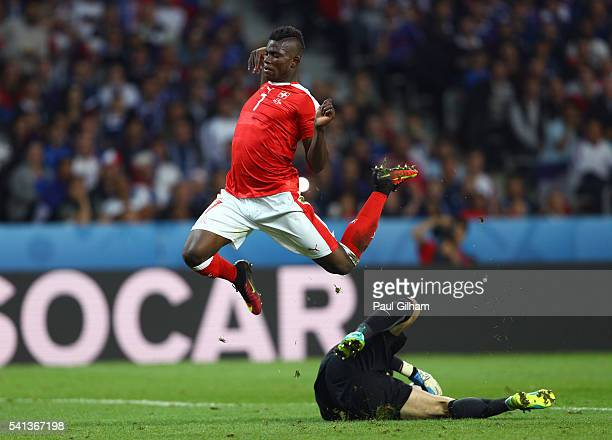 Breel Embolo of Switzerland and Hugo Lloris of France compete for the ball during the UEFA EURO 2016 Group A match between Switzerland and France at...