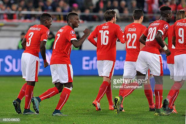 Breel Embolo of Switzerland celebrates with his teammates scoring the sixth goal during the UEFA EURO 2016 qualifier between Switzerland and San...