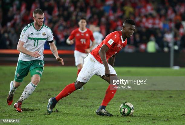 Breel Embolo of Switzerland Chris Brunt of Northern Ireland during the FIFA 2018 World Cup Qualifier PlayOff Second Leg between Switzerland and...