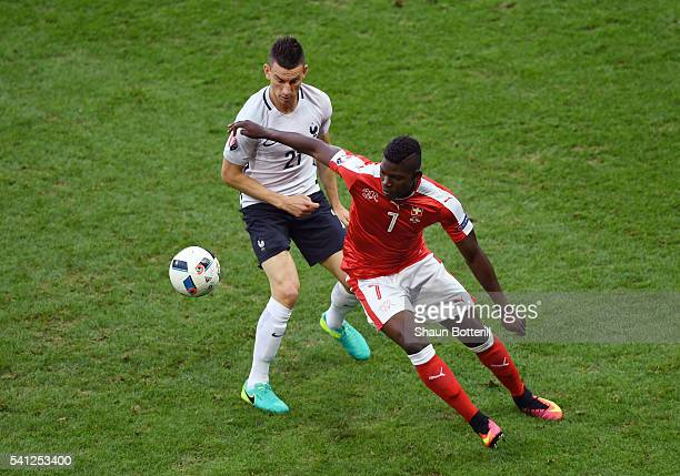 Breel Embolo of Switzerland controls the ball under pressure of Laurent Koscielny of France during the UEFA EURO 2016 Group A match between...