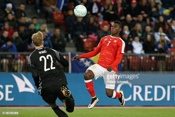 Breel Embolo of Switzerland fights for the ball with goalkeeper Jasmin Buric of BosniaHerzegovina during the international friendly match between...