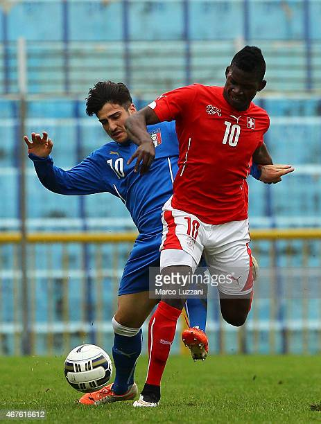 Breel Embolo of Switzerland is challenged by Gennaro Acampora of Italy during the 4 Nations Tournament match between Italy U20 and Switzerland U20 at...
