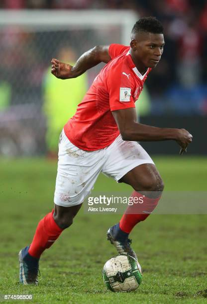 Breel Embolo of Switzerland runs with the ball during the FIFA 2018 World Cup Qualifier PlayOff second leg match between Switzerland and Northern...