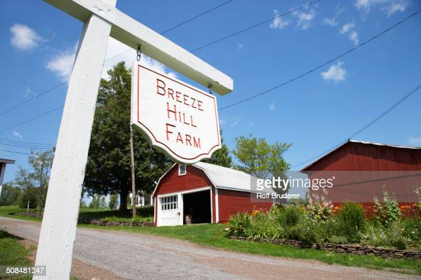 Breeze Hill Farm' sign on rural road