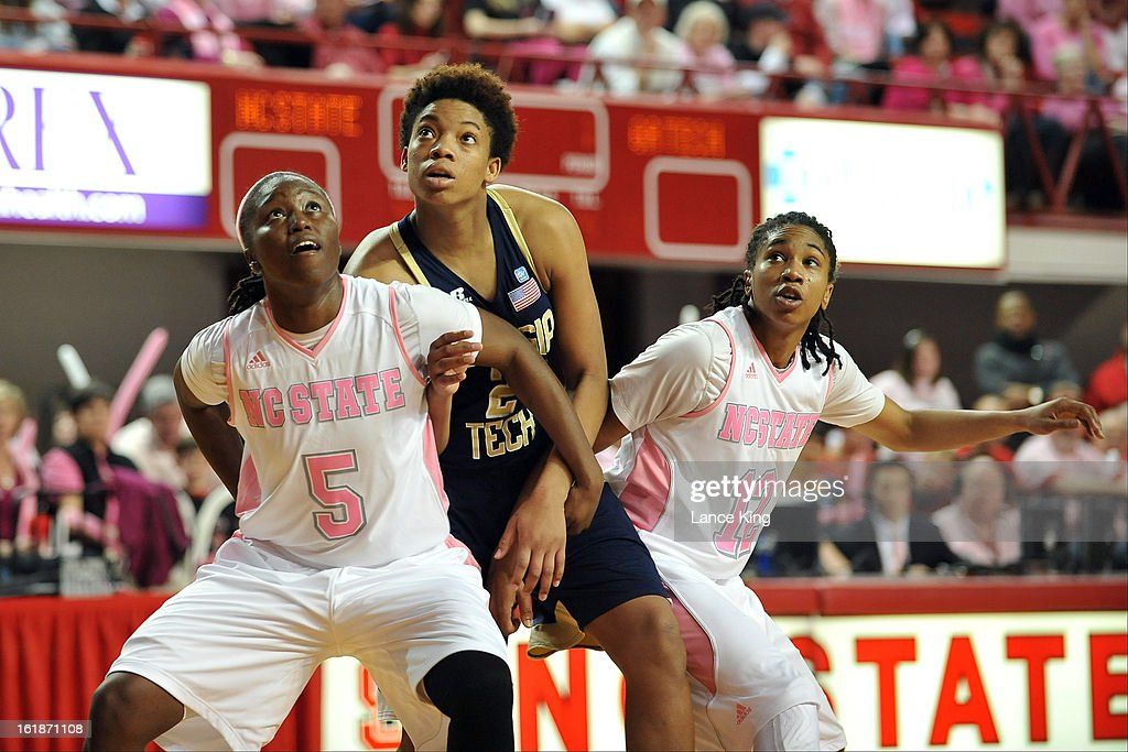 Breezy Williams #5 and Krystal Barrett #12 of the North Carolina State Wolfpack hold their position against Aaliyah Whiteside #2 of the Georgia Tech Yellow Jackets at Reynolds Coliseum on February 17, 2013 in Raleigh, North Carolina.