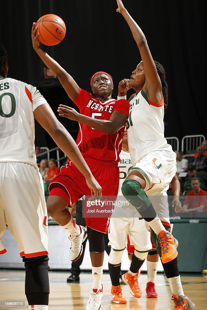 Breezy Williams #5 of the North Carolina State Wolfpack has her shot blocked by Macy Keen #31 of the Miami Hurricanes on December 20, 2012 at the BankUnited Center in Coral Gables, Florida. The Hurricanes defeated the Wolfpack 79-53.