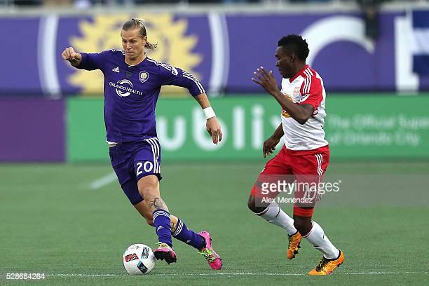 Brek Shea of Orlando City SC dribbles the ball past Lloyd Sam of New York Red Bulls during an MLS soccer match at Camping World Stadium on May 6 2016...