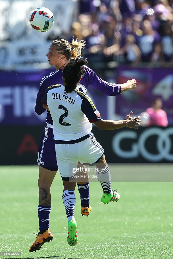 Brek Shea of Orlando City SC heads the ball against Tony Beltran of Real Salt Lake during a MLS soccer match at the Orlando Citrus Bowl on March 6...