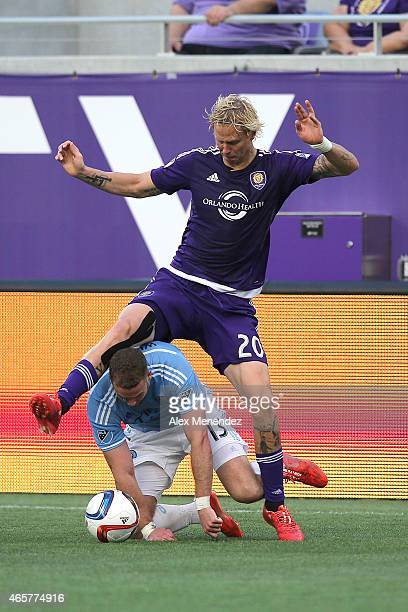 Brek Shea of Orlando City SC steps over Josh Williams of New York City FC to get the ball during an MLS soccer match between the New York City FC and...