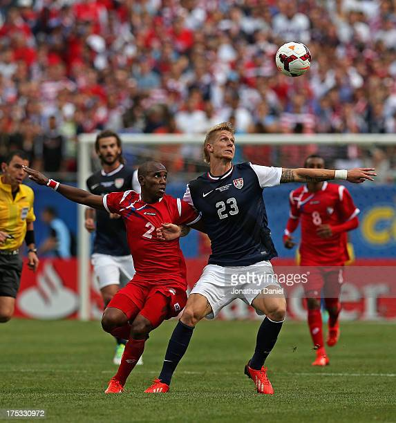 Brek Shea of the United States and Leonel Parris of Panama battle for the ball during the CONCACAF Gold Cup final match at Soldier Field on July 28...