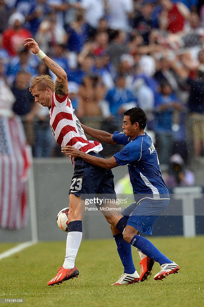 Brek Shea #23 of the United States battles for the ball against Xavier Garcia Orellana #2 of El Salvador in the second half during the 2013 CONCACAF Gold Cup quarterfinal game at M&T Bank Stadium on July 21, 2013 in Baltimore, Maryland.