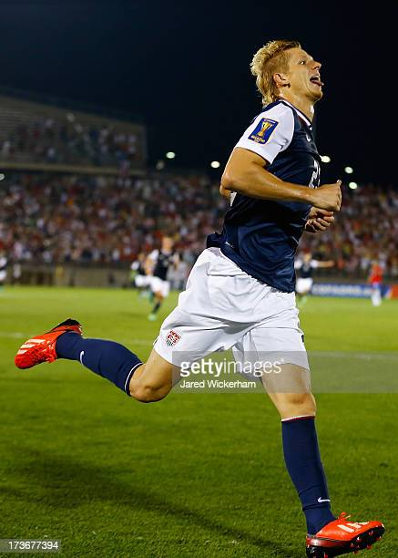 Brek Shea of the United States celebrates his goal after scoring late in the second half against Costa Rica during the CONCACAF Gold Cup match at...