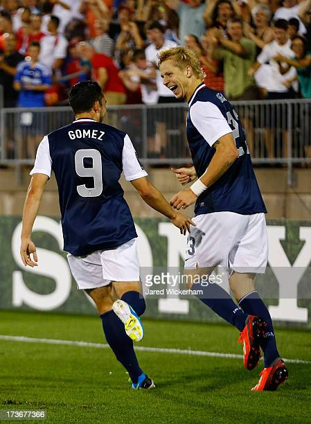 Brek Shea of the United States celebrates his goal with teammate Herculez Gomez after scoring late in the second half against Costa Rica during the...