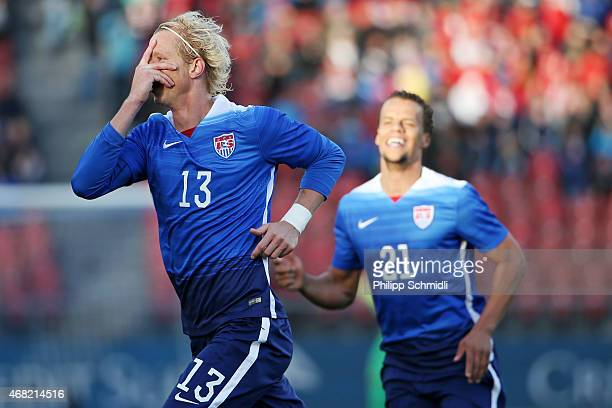 Brek Shea of the USA celebrates his scored goal with teammate Timmy Chandler during the international friendly match between Switzerland and the...
