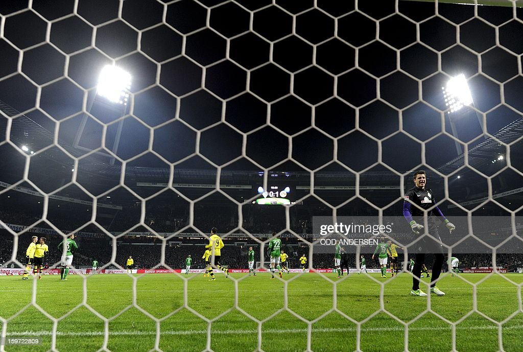 Bremen goalkeeper Sebastian Mielitz (R) reacts after missing a shot from Dortmund's Mario Goetze during the German first division Bundesliga football match Werder Bremen vs Borussia Dortmund at the Weser stadium in Bremen on January 19, 2013.