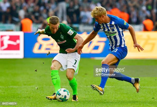 Bremen's Austrian midfielder Florian Kainz and Berlin's Norwegian midfielder Per Ciljan Skjelbred vie for the ball during the German first division...