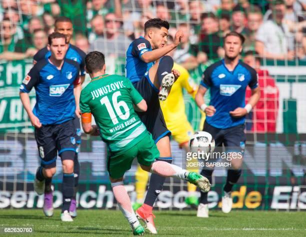 Bremen's Austrian midfielder Zlatko Junuzovic and Hoffenheim's midfielder Nadiem Amiri vie for the ball during the German first division Bundesliga...