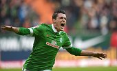 Bremen's Austrian midfielder Zlatko Junuzovic celebrates after scoring during the German first division Bundesliga football match SV Werder Bremen vs...