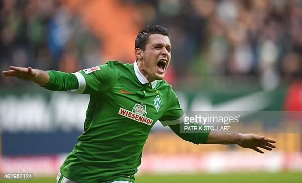 Bremen's Austrian midfielder Zlatko Junuzovic celebrates after scoring during the German first division Bundesliga football match SV Werder Bremen vs...