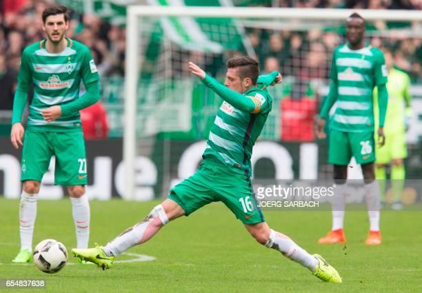 Bremen's Austrian midfielder Zlatko Junuzovic plays the ball during the German First division Bundesliga football match Werder Bremen vs RB Leipzig...