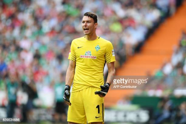 Bremen's Czech goalkeeper Jiri Pavlenka reacts during the German First division Bundesliga football match between Werder Bremen and Bayern Munich in...