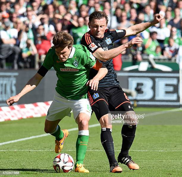 Bremen's defender Clemens Fritz and Hamburg's Serbian midfielder Ivica Olic vie for the ball during the German first division Bundesliga football...