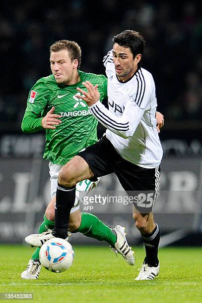 Bremen's defender Philipp Bargfrede vies for the ball with Wolfsburg's midfielder Chris during the German first division Bundesliga football match SV...