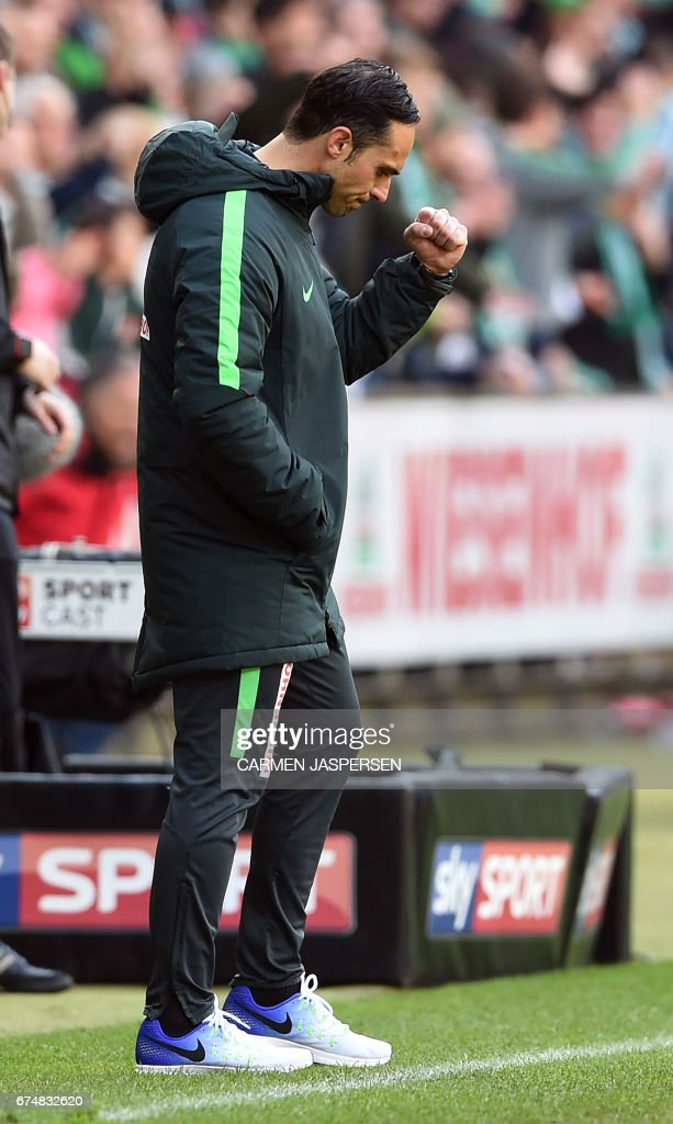 Bremen's head coach Alexander Nouri reacts after winning the German first division Bundesliga football match between Werder Bremen and Hertha Berlin on April 29, 2017 in Bremen, northern Germany. / AFP PHOTO / dpa / Carmen Jaspersen / NO Getty Images (GETTY-VD) - Germany