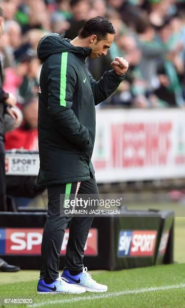Bremen's head coach Alexander Nouri reacts after winning the German first division Bundesliga football match between Werder Bremen and Hertha Berlin...