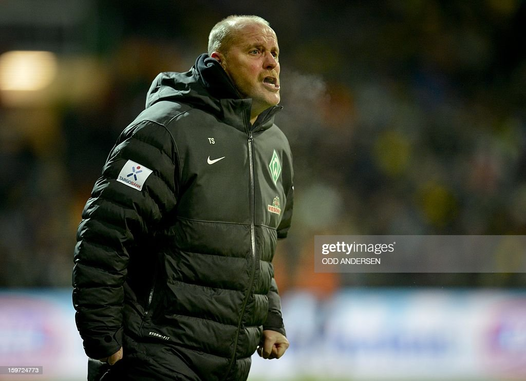 Bremen's head coach Thomas Schaaf reacts during the German first division Bundesliga football match Werder Bremen vs Borussia Dortmund at the Weser stadium in Bremen on January 19, 2013.