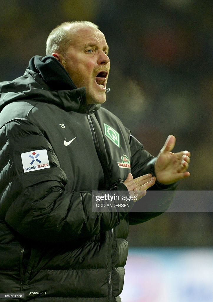 Bremen's head coach Thomas Schaaf reacts during the German first division Bundesliga football match Werder Bremen vs Borussia Dortmund at the Weser stadium in Bremen on January 19, 2013. AFP PHOTO / ODD ANDERSEN