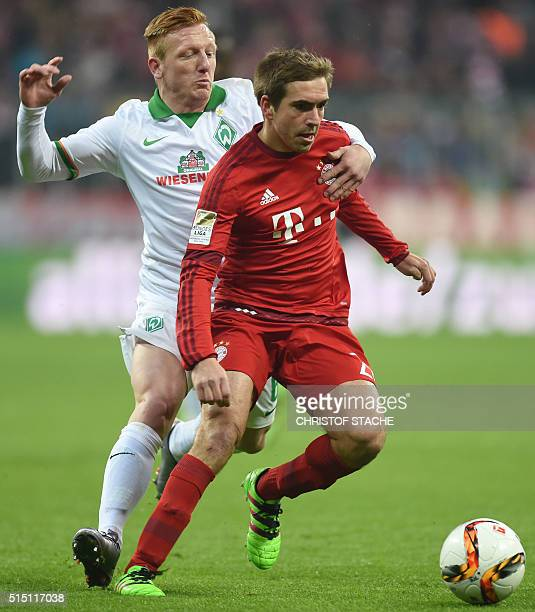 Bremen's Hungarian midfielder Lazlo Kleinheisler and Bayern Munich's defender Philipp Lahm vie for the ball during the German first division...