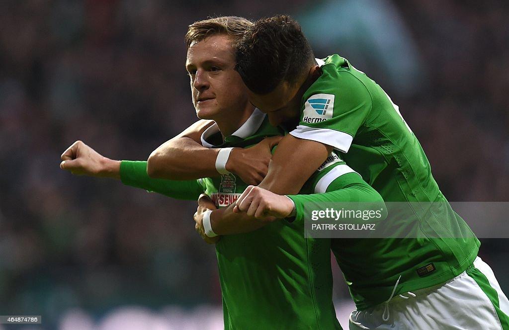 Bremen's midfielder Felix Kroos and Bremen's striker Davie Selke celebrate after scoring during the German first division Bundesliga football match...