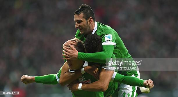 Bremen's midfielder Felix Kroos Bremen's striker Davie Selke and Bremen's midfielder Levin Oeztunali celebrate after scoring during the German first...