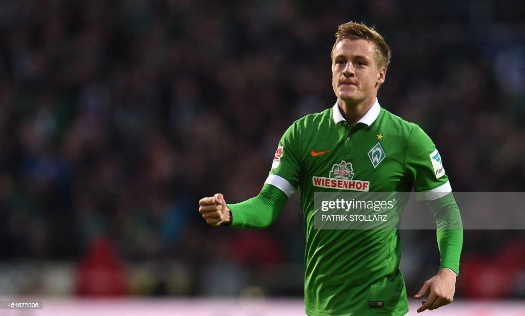 Bremen's midfielder Felix Kroos celebrates after scoring during the German first division Bundesliga football match SV Werder Bremen vs VfL Wolfsburg...