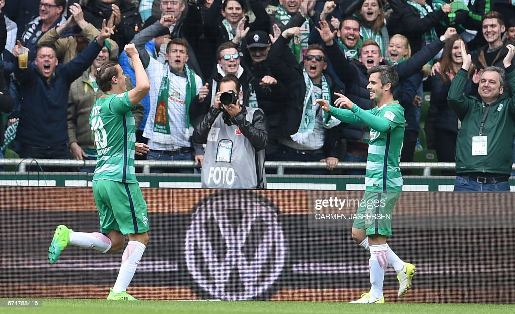 Bremen's midfielder Fin Bartels and Bremen's forward Max Kruse celebrate the 2:0 during the German first division Bundesliga football match between Werder Bremen and Hertha Berlin on April 29, 2017 in Bremen, northern Germany. / AFP PHOTO / dpa / Carmen Jaspersen / NO Getty Images (GETTY-VD) - Germany