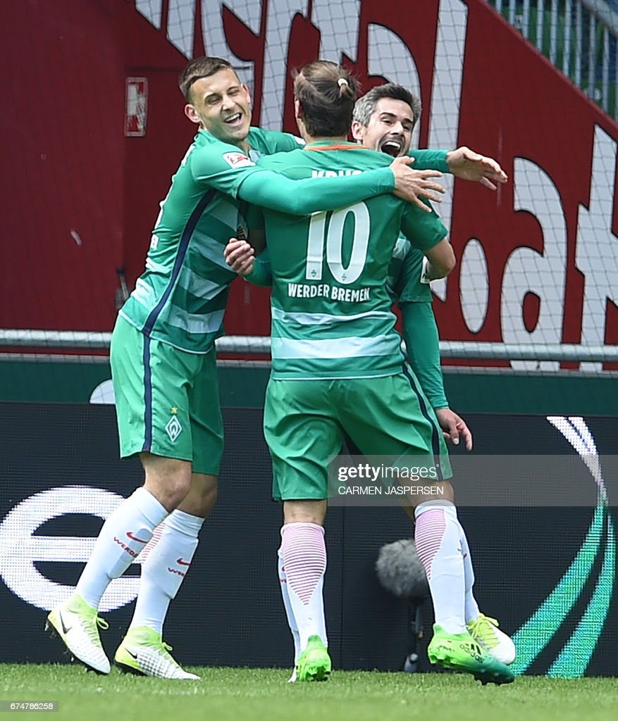 Bremen's midfielder Fin Bartels celebrates scoring the 1:0 with Bremen's forward Max Kruse (C) and Bremen's midfielder Maximilian Eggestein (L) during the German first division Bundesliga football match between Werder Bremen and Hertha Berlin on April 29, 2017 in Bremen, northern Germany. / AFP PHOTO / dpa / Carmen Jaspersen / NO Getty Images (GETTY-VD) - Germany
