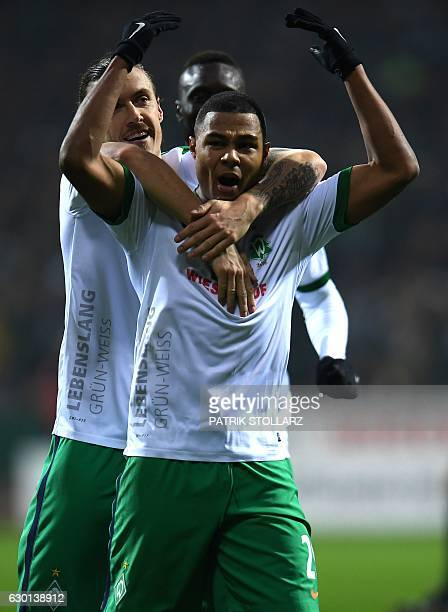 Bremen's midfielder Max Kruse and Bremen's midfielder Serge Gnabry celebrate during the German first division Bundesliga football match Werder Bremen...