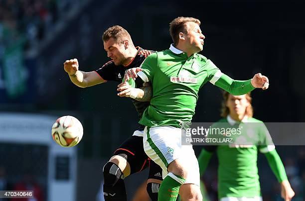 Bremen's midfielder Philipp Bargfrede and Hamburg's forward PierreMichel Lasogga vie for the ball during the German first division Bundesliga...