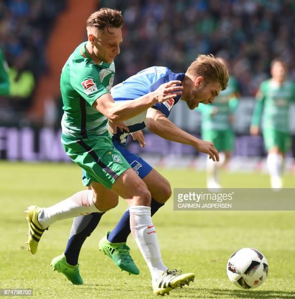Bremen's midfielder Robert Bauer and Berlin's midfielder Alexander Esswein vie for the ball during the German first division Bundesliga football...