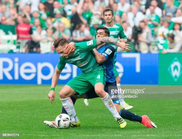 Bremen's midfielder Robert Bauer and Hoffenheim's midfielder Nadiem Amiri vie for the ball during the German first division Bundesliga football match...