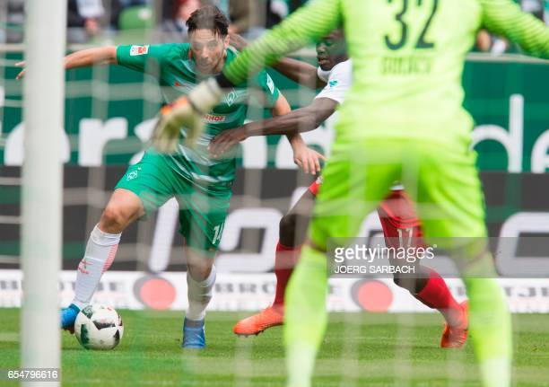 Bremen's Peruvian forward Claudio Pizarro and Leipzigs defender Dayot Upamecano vie for the ball during the German First division Bundesliga football...