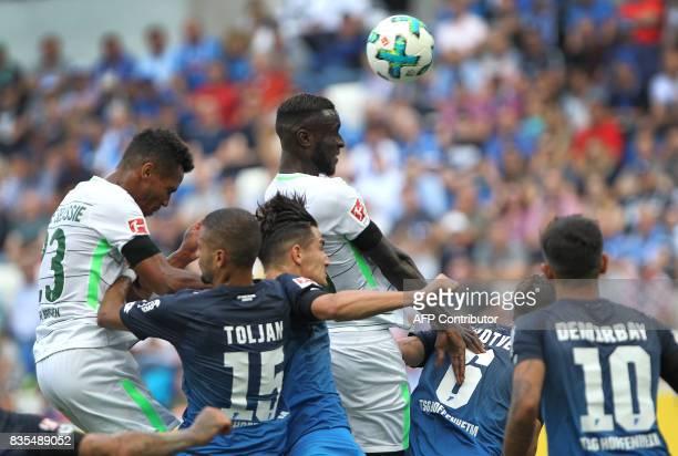 Bremen's Senegalese defender Lamine Sane get to the ball ahead of Hoffenheim's defender Benjamin Huebner during the German First division Bundesliga...