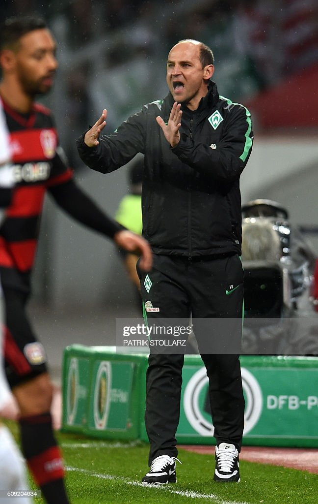 Bremen's Ukrainian head coach Viktor Skripnik reacts during the German Cup ( Pokal ) quarter final football match Bayern 04 Leverkusen v SV Werder Bremen on February 9, 2016 in Leverkusen. / AFP / PATRIK STOLLARZ / AT +49 69 67880 /