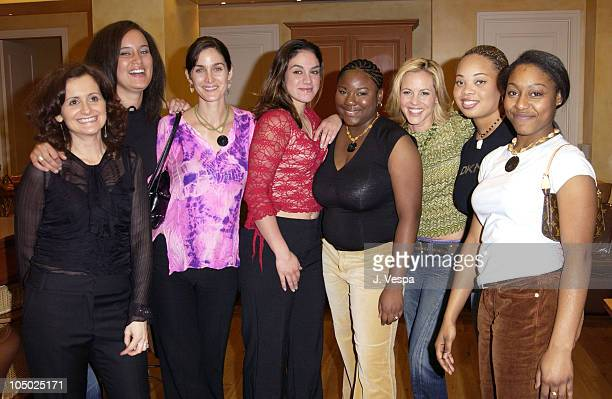 Brenda Battista Director of Hands of Change CarrieAnne Moss Maria Bello and women from the Hands of Change Program